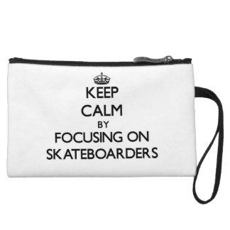 Keep Calm by focusing on Skateboarders Wristlet Clutch