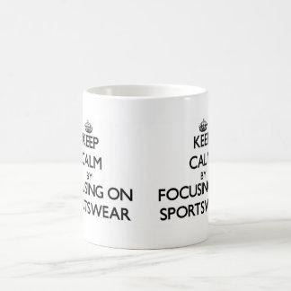 Keep Calm by focusing on Sportswear Coffee Mugs