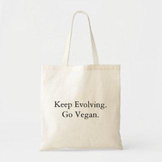 Keep Evolving, Go Vegan. Tote Bag