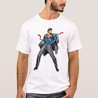 Kent changes into Superman T-Shirt