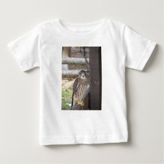 Kestrel perched on a fence post baby T-Shirt
