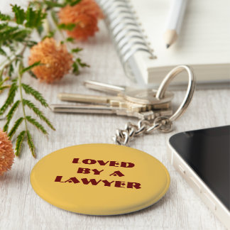 Key chain: Loved by a lawyer Basic Round Button Key Ring