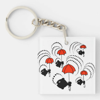 Keychain with little black fishes and red umbrella