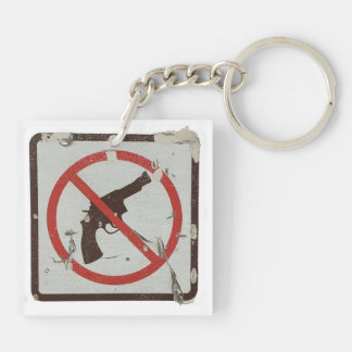 Keychain with old sign with graphic no guns