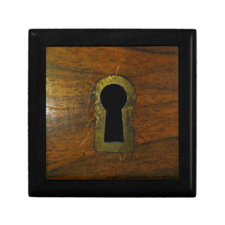 Keyhole in a wooden door gift box