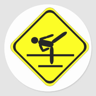kicking sign round sticker