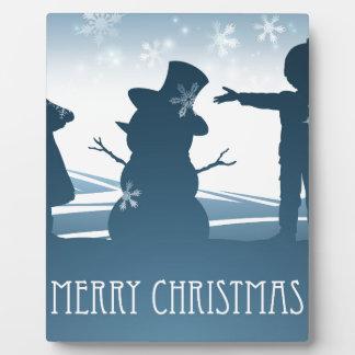 Kids Building Snowman Christmas Scene Plaque