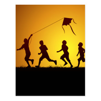Kids flying a kite postcard