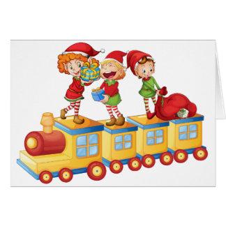 kids playing on train greeting card