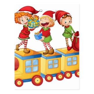 kids playing on train postcard