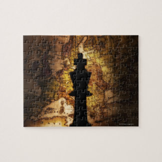 King chess piece on old world map jigsaw puzzle