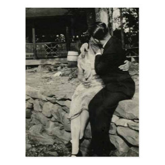 Kissing on the stone wall post card