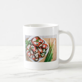 Kitchen table with a dish of stewed eggplant coffee mug