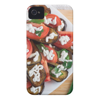 Kitchen table with a dish of stewed eggplant iPhone 4 cover