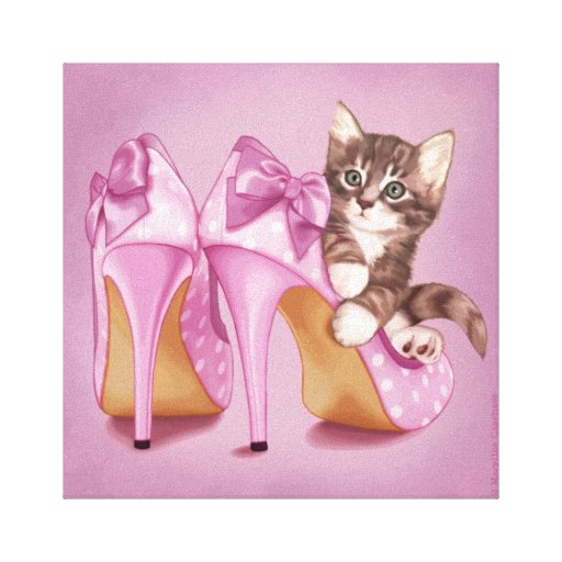 Kitten in purple shoe stretched canvas prints