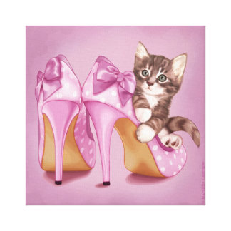 Kitten in purple shoe stretched canvas print
