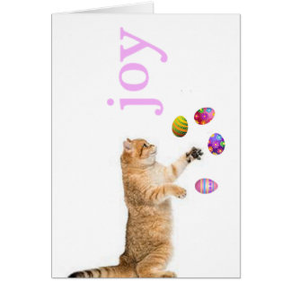 Kitten juggles Easter eggs Card