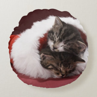 Kittens asleep together in Christmas hat Round Cushion