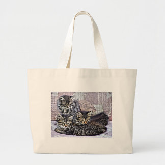 Kittens relaxing on a chair large tote bag