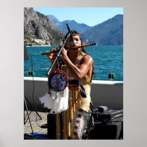 Kjari playing a pipe at Lake Garda Poster