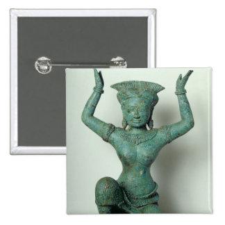 Kneeling feminine figure  used to support a 15 cm square badge