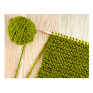 Knitting with green wool postcard