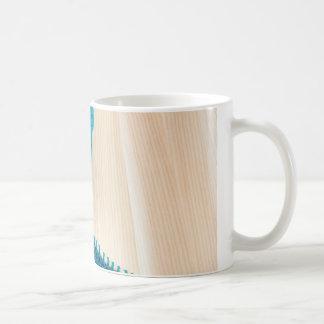 Knitting with teal yarn coffee mug