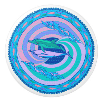 Knob with colorful design of dolphins swimming