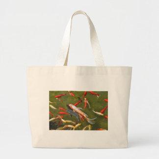 Koi carps in pond large tote bag