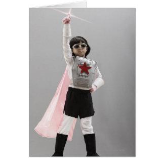 Korean girl in superhero costume with arm raised card
