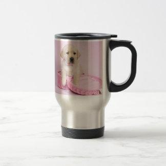 Labrador retriever puppy on pink background travel mug