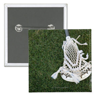 Lacrosse stick on grass 15 cm square badge