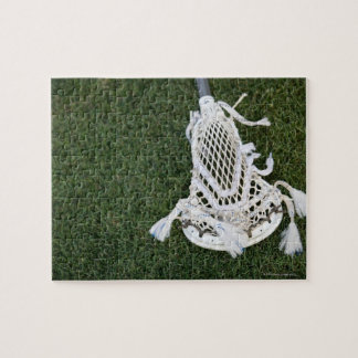 Lacrosse stick on grass jigsaw puzzle