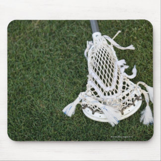 Lacrosse stick on grass mouse pad