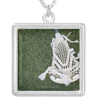 Lacrosse stick on grass silver plated necklace