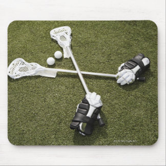 Lacrosse sticks, gloves and balls on artificial mouse pad