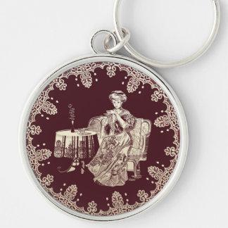 lady drinks tea key ring
