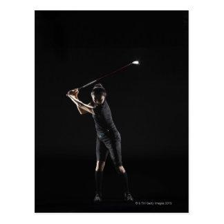 Lady golfer who swings driver postcard