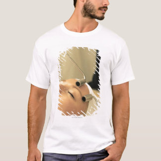 Lady having face massage T-Shirt
