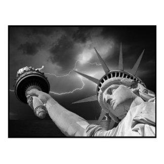Lady Liberty under a stormy sky Postcard