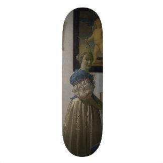 Lady Standing at a Virginal by Johannes Vermeer Skate Boards