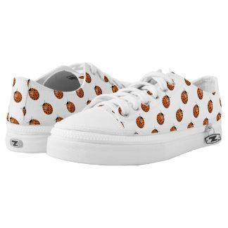Ladybug in orange printed shoes