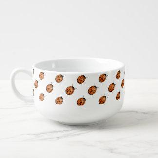 Ladybug in orange soup mug
