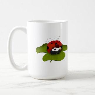 Ladybug on a green leaf classic white coffee mug
