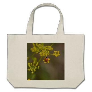 Ladybug on yellow flower bags