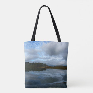 Lagoon reflections on a cloudy day tote bag