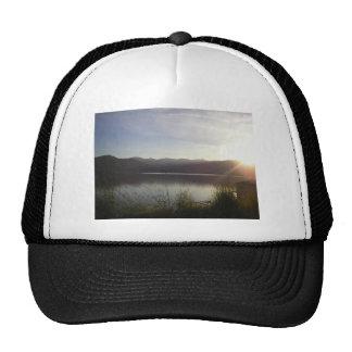 lake at sunset trucker hat