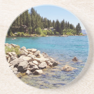 Lake Tahoe's clear waters with snowy mountains Coaster