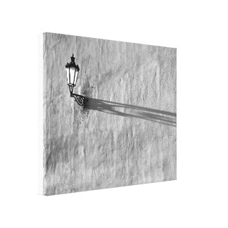 Lamp and shadow on wall canvas print