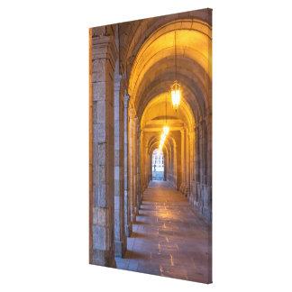 Lamp lit stone hallway, spain canvas print